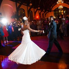 """The newlyweds took a spin to """"Change Your World"""" by Anthony Hamilton for their first dance."""