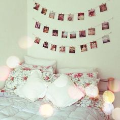 bedroom. Really like the light colored wall contrasting with the photo's(: Makes it seem vintagey!