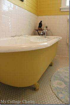 penny round tiles and painted horizontal boards to match tub--THIS!!!! @leah wright this is your bathroom!!!