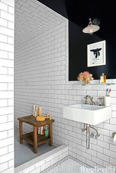 """I wanted the nostalgic look of a black-and-white bathroom,"" Leslie Klotz says of the space in her Manhattan apartment. ""And I used high-gloss paint"" — Benjamin Moore's Black — ""because it felt sexy."" Duravit sink with Rohl fittings.   - HouseBeautiful.com"