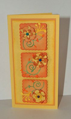 handmade card ... Bountiful Blossoms ... tall and slender format (#10) ... mustard and orange .. three twinchies with die cut flourish and layer d flowers .. luv the warm colors on this card ...