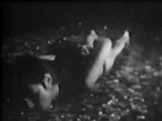 Chris BURDEN  Through the night softly . In 1973 Chris Burden conceives the work Through the Night Softly, to be inserted during 10 seconds amongst the regular Tv advertisements, 4 times a week for 4 weeks.  In the original video, longer than the tv ad, he held his hands behind his back and crawled through about 50 feet of glass in Los Angeles pavement at nigh time.
