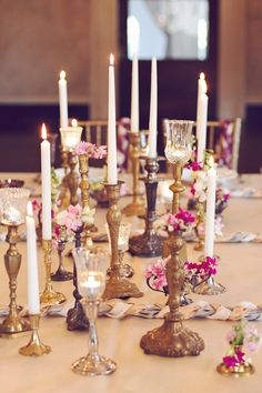 substitute floral centerpieces for a collection of vintage candlesticks, photo by Amy Nicole Photography http://ruffledblog.com/bohemian-luxe-winter-wedding #weddingideas #centerpieces #candlesticks