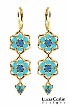 Lucia Costin Dangle Flower Earrings Made of 14K Yellow Gold Plated over .925 Sterling Silver with Blue, Turquoise Swarovski Crystal Flowers, Twisted Lines and Lovely Charms; Handmade in USA Lucia Costin. $79.00. Unique jewelry handmade in USA. Dangle earrings beautifully designed by Lucia Costin. Amazingly studded with sapphire and turquoise Swarovski crystals. Mesmerizing enough to wear on special occasions, but durable enough to be worn daily. A perfect feminine touch