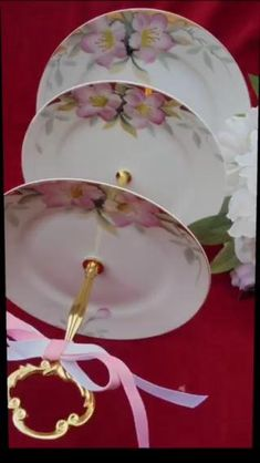 GORGEOUS FLORAL CAKE STAND WITH GOLDEN TRIM IS HANDCRAFTED FROM ANTIQUE NORITAKE AZALEA PLATES #azalea #cakestand #azaleanoritake #mothersday #momgift #chinoiserie #homedecor #chinoisriechic #bridalgift #desserttable #weddinhdesserttable #antiques #teaparty #giftidea #pagodacakestand #weddingplanning #weddingplanner #weddingideas #weddingdiscount #bluewhitestudio Wedding Cake Stands, Unique Wedding Cakes, 3 Tier Cake Stand, Birthday Party Centerpieces, Pink Cupcakes, Floral Cake, Antique China, Noritake, Bridal Gifts