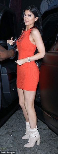Kylie Jenner wears red bodycon dress and  cream ankle boots #dailymail