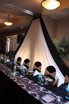 Draping behind wedding parties table. Just add some white lights and some shimmery stuff to get a wintery feel.