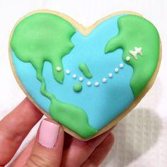 Have cookie, will travel! ✈️ #themonogrammedmacaroon #cookieart #sugarcookies #royalicingcookies #globecookie #travelcookies