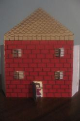 Making a house out of a cereal box... This would be fun for a fairy house or something...