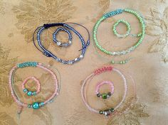 Friendship bracelet/ring sets in 4 different colourways.