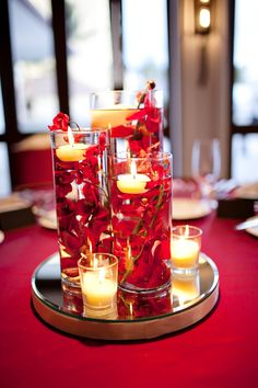 Our DIY red wedding submerged floral centerpieces, Halekulani Hau Terrace
