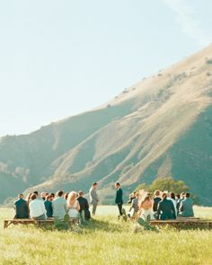 The Ceremony: wooden benches, mountain scape, wind in the grass