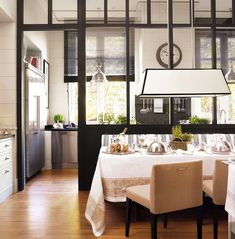 Marvelous cream and black kitchen/dining area separated by glass walls by Deulonder Domestic Architecture via nicety--other pictures in article