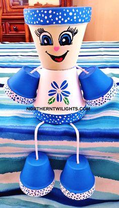 Blue Flower Dots Clay Pot Head People Terra Cotta - It's a Girl Flower Pot Art, Clay Flower Pots, Flower Pot Crafts, Cactus Flower, Clay Pot Projects, Clay Pot Crafts, Diy Clay, Flower Pot People, Clay Pot People