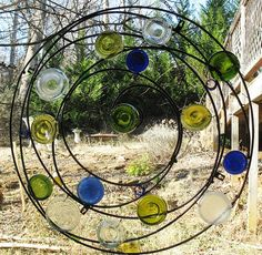 Wrought Iron Circle with Recycled Glass Bottle Bottoms. Mosaic Art, Mosaic Glass, Fused Glass, Stained Glass, Mosaic Mirrors, Land Art, Glass Garden, Garden Art, Bottle Art