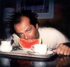 I'M NOT REALLY HUNGRY.  Jack Nicholson contemplates eating a slice of watermelon.