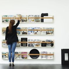 SkabRum, Wall with magazine rack in leather & birch plywood.