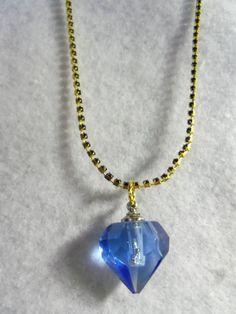 Blue Glass  Vial Pendant. $10.99, via Etsy.