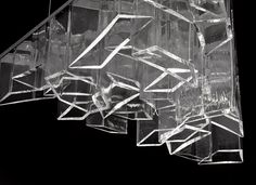 Ice, designed by Daniel Libeskind. The ICE chandelier challenges the traditionally round forms of Czech hand-blown glass with its sharp, angular design. The result is a spectacular deformation of geometric elements that fit together like a puzzle inside a one meter equilateral triangle.