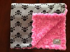 gray with black skulls and hot pink minky rose backing