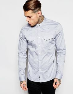 "Shirt by Religion Woven cotton Point collar Button through fastening Press stud pockets Signature logo Curved hem Regular fit - true to size Machine wash 100% Cotton Our model wears a size Medium and is 185.5cm/6'1"" tall"