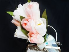 How to make tulips from crepe papers or tissue papers easily. Plus steps to wrap those paper tulips to form a bouquet