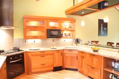 Cherry Wood Cabinets- corner sink, built in microwave, wood paneled dish washer drawers, glass door wall cabinets, cherry cabinets, granite countertops Cherry Wood Cabinets, Wood Kitchen Cabinets, Wall Cabinets, Wood Glass Door, Glass Doors, Cherry Kitchen, Corner Sink, Built In Microwave, Door Wall