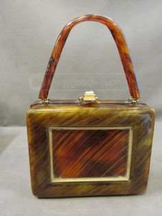 shopgoodwill.com: Vint Lucite Tortoiseshell Purse Llewellyn/Lewisd Sold for $101