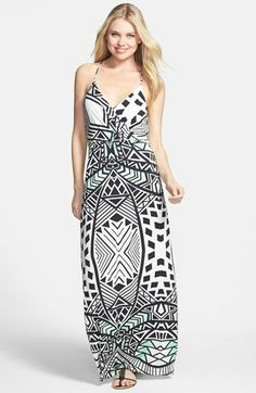 Print Stretch Jersey Maxi Dress Slim straps suspend the plunging surplice bodice of a supersoft stretch-jersey maxi wrapped in a graphic geometric print brushed with verdant color for tropical appeal. Gentle gathers at the inset waist create flattering dimension, and the low back enhances the breezy, laid-back style.