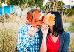 A stolen kiss behind the leaves:) <3 this colorful engagement session by http://bakephotography.com