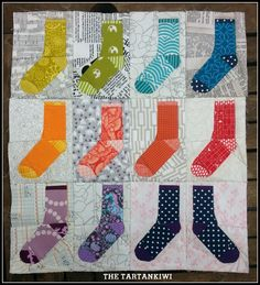 "Fun ""Odd Socks"" mini-quilt by Juliet of Tartankiwi. paper-pieced pattern available for $2.50 here: http://www.craftsy.com/pattern/quilting/other/odd-socks/122252"