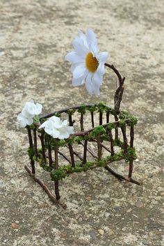 Miniature Baby Crib by Fairies of Tranquility This sweet little crib has a beautiful daisy mobile hanging above and lovely white flowers adorning the rocking cot - making this the perfect place for your fairy baby. The miniature crib measures approximately 9 cm long, 6 cm wide