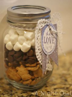 This would be a very cute favor!  smore's in a jar