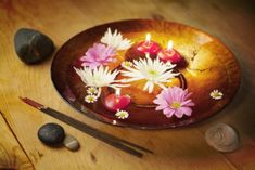 floating candles, essential oils, flowers, stones, the dish