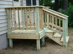 Nice Small Deck For The Garage Door!