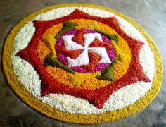 Flower rangoli designs are the most special ones, that is used among the many cultures. Check out some of the latest floral rangoli designs you should try in this Rangoli Designs Flower, Rangoli Patterns, Rangoli Ideas, Rangoli Designs Diwali, Diwali Rangoli, Rangoli Designs With Dots, Flower Rangoli, Beautiful Rangoli Designs, Flower Designs