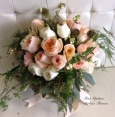 Peach bridal bouquet with Juliet garden roses and Tiffany roses.