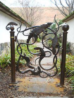 Garden Gates    cool gate  needs a garden to go with it.