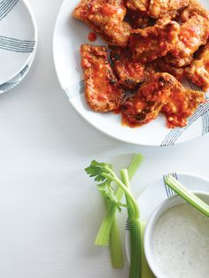 A basic hot wing sauce gets its punch from sambal oelek. Serve the wings hot with celery sticks and blue cheese dressing.