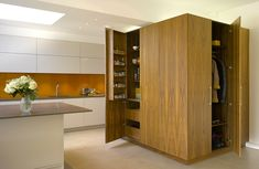 Multi purpose tall metro veneer cupboard in this white matt lacquer urbo Roundhouse kitchen