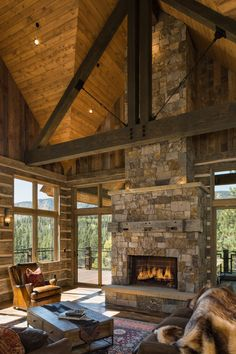 5 bed, 5 bath mining-style rustic wood and stone architecture with mountain views. This stone fireplace features a reclaimed wood mantel that is over 100 years old.