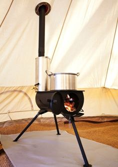 """Portable wood stove with water heater attachment on chimney. Can be used indoors or out. Looks like a useful item for our """" Emergency Kit"""". Anevay.co.uk"""