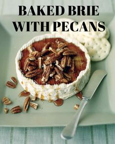 Baked Brie with Pecans | Martha Stewart Living - Toasted pecans and maple syrup complement the creamy Brie in this hors d'oeuvre. For the best texture, let the cheese cool before topping it with the syrup mixture. This recipe is by Everyday Food reader Kathy Quinn of Montclair, New Jersey.