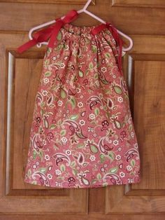 I made Lydia one of these from a pillowcase my grandmother embroidered...so cute!  Pillowcase Dress How To.  First sewing project = Hoping to make my girls pillowcase dresses for Valentine's Day :)