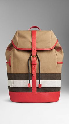 Bright military red Canvas Check Backpack from Burberry - A canvas check backpack with grainy leather trim. Foldover top, concealed drawcord closure and buckle fastening. Discover the women's bags collection at Burberry.com