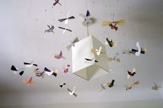 Wonderful, easy to make, paper birds that would make a beautiful suspended mobile for a baby's room.