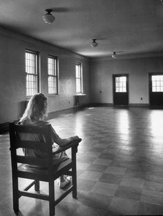 Woman sitting alone in room, in hospital that studies mental disorders. Location: Worchester, MA, US Date taken: August 1949 Photographer: Herbert Gehr LIFE Magazine