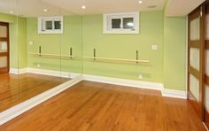 Dance studio in basement pictured here...  Sliding doors connect to an exercise room - this is pretty neat <3