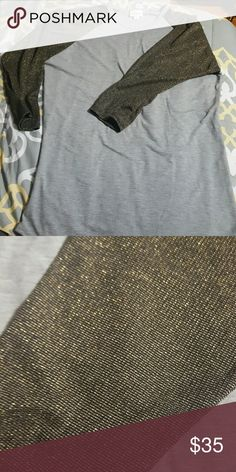 Medium Randy baseball style shirt Medium elegant  Randy with gray body and gold stitched sleeves. Looks super cute with the bronze Cassie also in my closet.  Bundle and save!! Never worn but did wash per instructions because it smelled like plastic from the shipping package from consultant. LuLaRoe Tops Tees - Long Sleeve