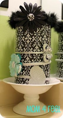 oatmeal container + scrapbook paper = cute head band holder  storage Great idea for someone that wears headbands